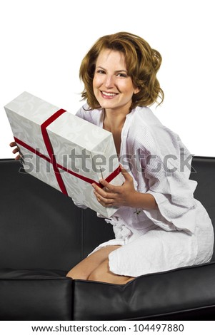 woman in bathrobe is surprised in the morning with a gift - stock photo
