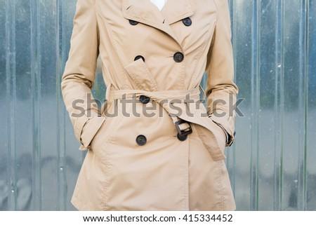 Woman in beige coat outdoors closeup Stock photo ©