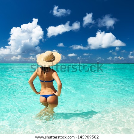 Woman in bikini at tropical beach #145909502