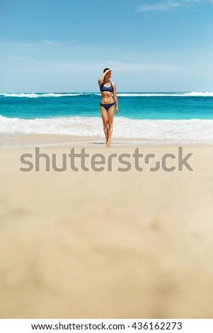 Woman In Bikini On Beach. Sexy Happy Girl With Fit Body, Healthy Sun Tan In Fashion Sport Swimwear Looking Far Away, Relaxing On Summer Vacations At Luxury Resort. Beautiful Female Enjoying Summertime #436162273