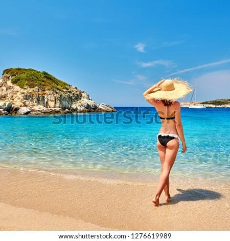 Woman in bikini on beach, Sithonia, Greece