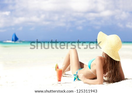 woman in bikini with fresh watermelon juice on tropical beach