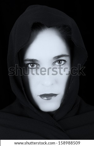 Woman in black cape with sad face and red lips portrait artistic conversion