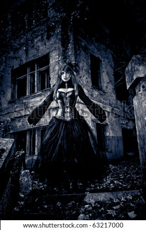 Woman in black dress from nightmare or fantasy - stock photo