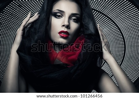 woman in black hood under grate dome