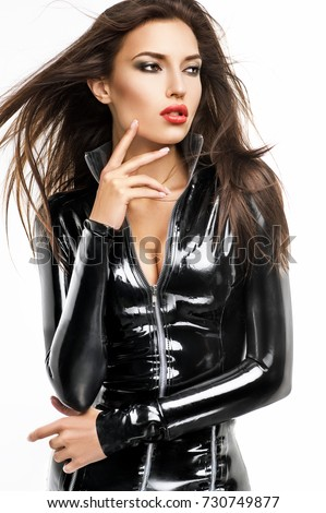 Woman in black latex costume