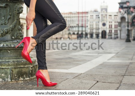 Woman in black leather pants and red high heel shoes #289040621