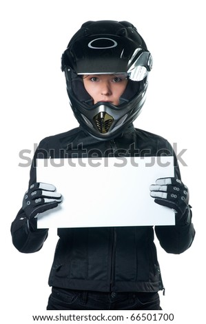 Woman in black motorcycle clothing and helmet holding a white board. Isolated on white.