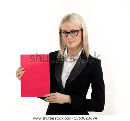 woman in black suit with poster in hands