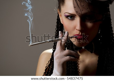 stock photo woman in black veil with a cigarette holder 54837475