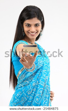 woman in blue costume showing credit card
