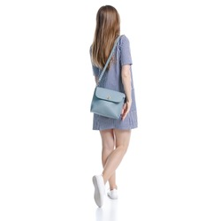 Woman in blue dress with bag looking walking goes on white background isolation, back view
