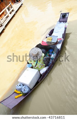 Woman in boat at Floating Market, Thailand