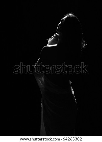 Woman in body style studio shot looking towards the light