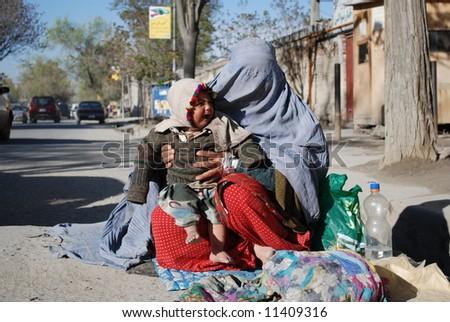 Woman in burka begging