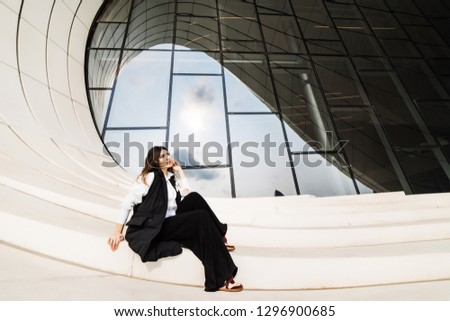 woman in business suit posing at camera