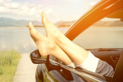 Woman in car. Summer vacation and travel, romantic road trip.