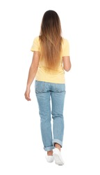 Woman in casual outfit walking on white background, back view