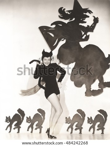 woman in cat costume posing...