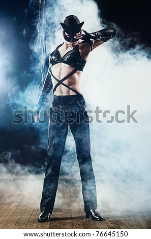 Woman in cat suit with smoke effect.