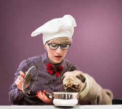 Woman in chef's hat and her dog tasting food, purple background