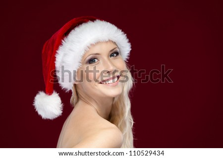 Woman in Christmas cap, isolated on purple