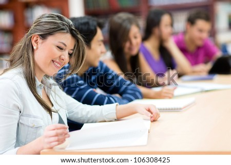 Woman in class surrounded by other students