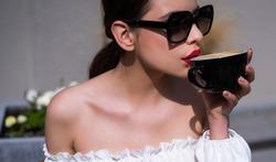 Woman in coffeeshop drinking coffee. Morning breakfast