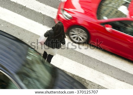 woman  in dangerous situation in crosswalk  with traffic lights in street city