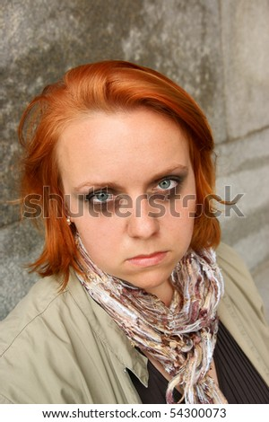 Woman in depression near old stone wall