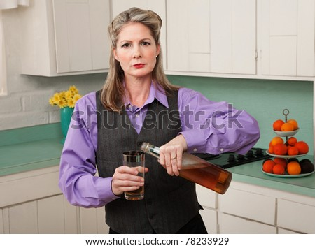 Woman in drag pouring alcohol into a glass