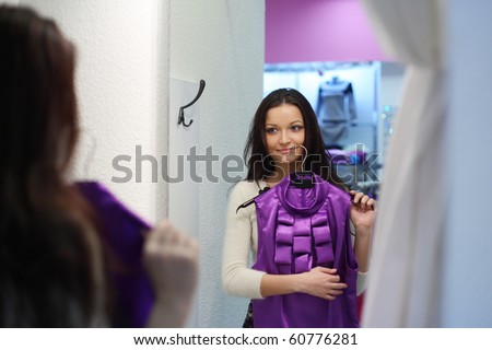 woman in dress room - stock photo