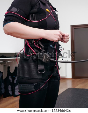 Woman in electro muscular stimulation suit ready for exercises #1223466436