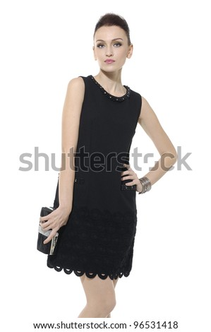 woman in elegant dress with purse posing