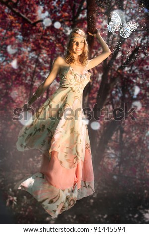 Woman in Fantasy scene with butterfly during autumn/fall - stock photo