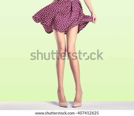 woman in fashion skirt and high ...