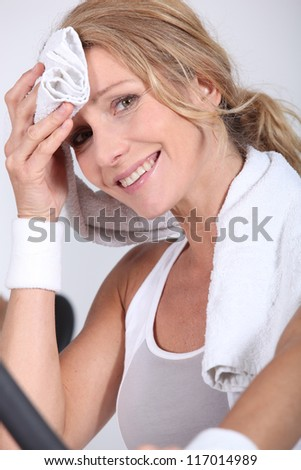 woman in fitness clothes with towel