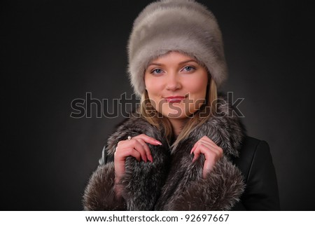 woman in fur hat and fur coat