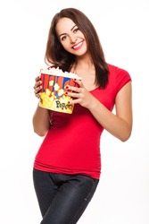 woman in glasses holding popcorn in his hands and smiling