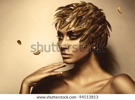 woman in gold feather hat - stock photo