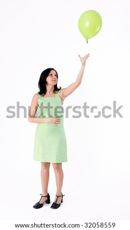 woman in green dress with green balloon