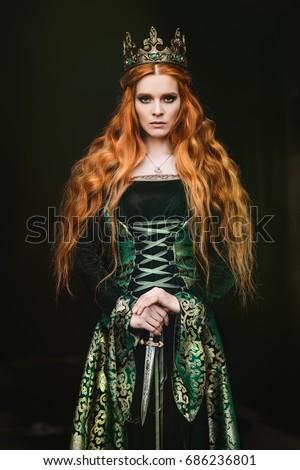 Woman in green medieval dress - Shutterstock ID 686236801