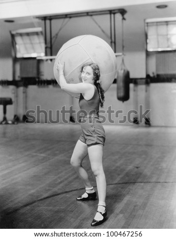 woman in gymnasium with huge...