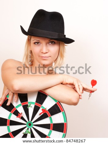 woman in hat holds board for darts on white background