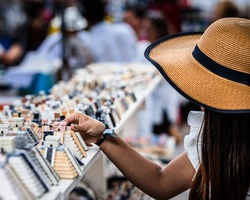 Woman in hat looking at Mexican souvenirs
