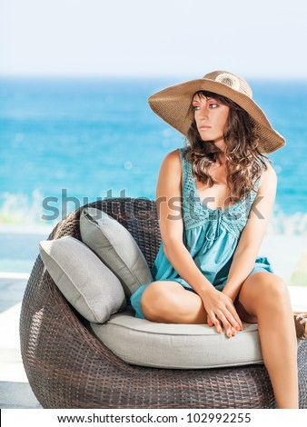 Woman in hat near the pool