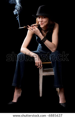 stock photo woman in hat with cigarette holder isolated on the black background 6885637