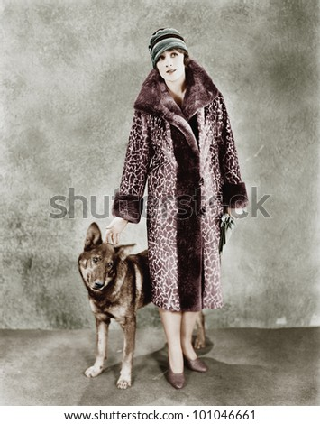 Woman in her Giraffe patterned fur coat and her dog
