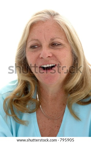 "Woman in her late fifties saying ""ahhhh"" photographed on a white background."