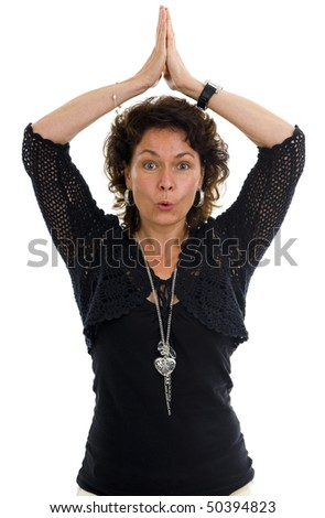 woman in her 40s in yoga position with eyes wide open, isolated on white background